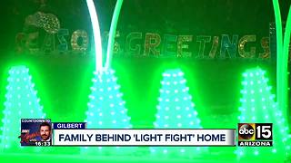 Gilbert family's holiday display premieres on Light Fight - Video