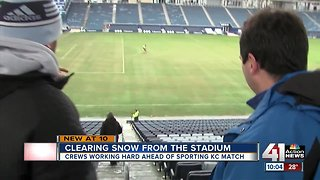 Sporting KC grounds crew clears field of snow