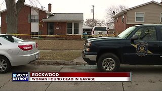 Police investigate death of woman found in garage