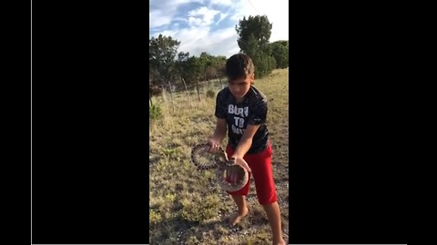 Real life Mowgli casually picks up rattlesnake