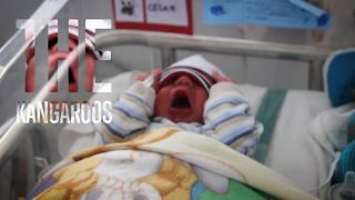 These professional baby cuddlers will melt your heart - Video