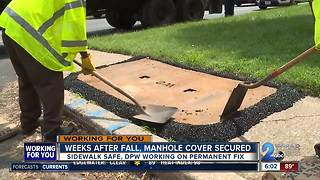 Weeks after fall, manhole cover secured - Video