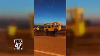 WATCH: Men disguised as bus try to cross bridge