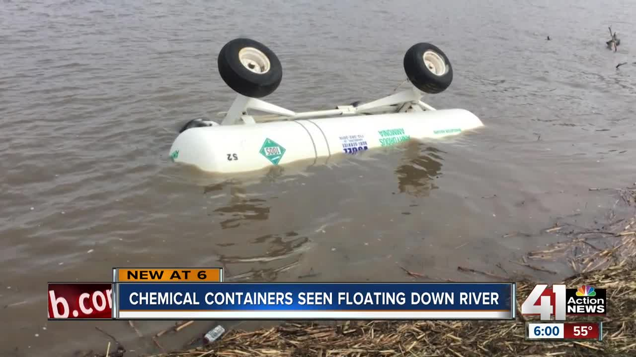 Historic flooding sends chemical containers floating downriver