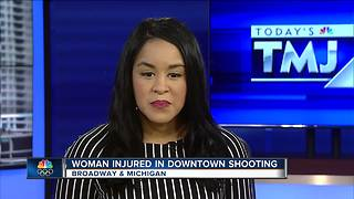 Woman shot in downtown Milwaukee - Video