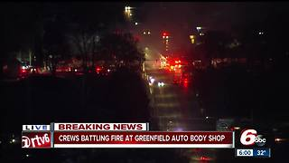Fire at auto body shop spreads to other businesses in Greenfield - Video