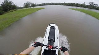 Australian Jet-Skiers Take Advantage of Dog Park Submerged by Cyclone Debbie - Video