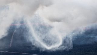 Incredible photos show rare 'ring twister' vortex captured for first time at Hawaii volcanic eruption site - Video