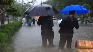Mumbai Locals Commute Through Flooded City Streets - Video
