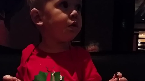 Baby confidently attempts to eat salad with fork