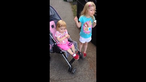 Toddler can't resist dancing to marching band