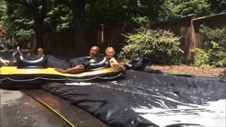 North Carolina Police Officer Takes a Plunge on a Slip-N-Slide - Video