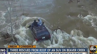 CRAZY! 3 people rescued from SUV's roof on Beaver Creek - Video