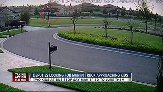 Deputies search for man in truck who tried to lure kids at bus stop - Video