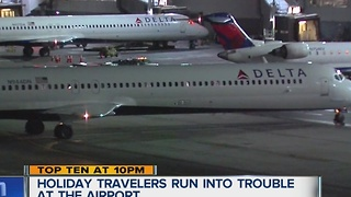 Holiday travelers run into trouble at Metro Airport - Video