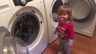 Helpful toddler loves to do the laundry