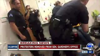 Disability advocates arrested by Denver police during sit-in at Cory Gardner's office - Video