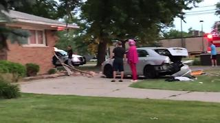 Car slams into Farmington Hills home - Video
