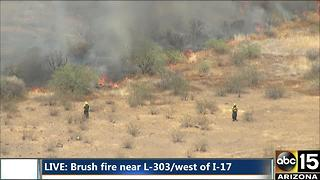 Air15 over a brush fire near the Loop 303 and I-17
