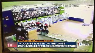 Video captures showdown between clerk and would-be robber - Video