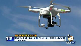 Sunbather confronts drone in her yard - Video