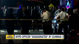 NYPD officer 'assassinated' by gunman - Video