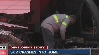 SUV crashes into home - Video