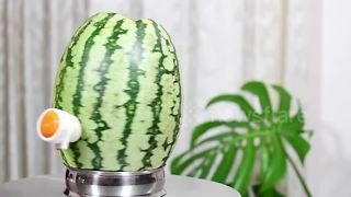 How to make your own watermelon juice dispenser - Video