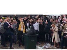 Cheltenham Crowds Cheer as Man Front Flips Into a Bin - Video