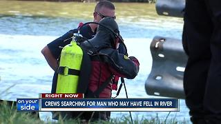 Divers search the Cuyahoga River for missing man - Video