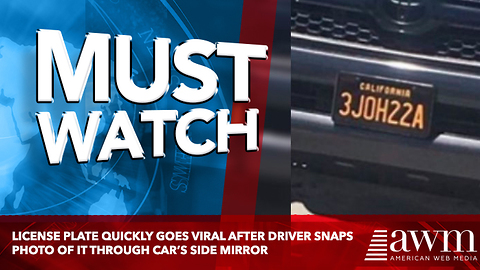 License Plate Quickly Goes Viral After Driver Snaps Photo Of It Through Car's Side Mirror