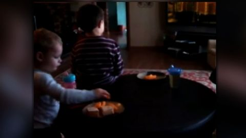 A little boy thinks he's getting away with something, but his older brother has other ideas.