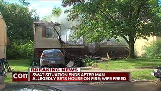 SWAT situation ends after house set on fire - Video