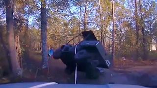 Cop Saves Child Trapped Under ATV - Video