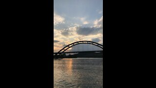 Sunset bridge by boat