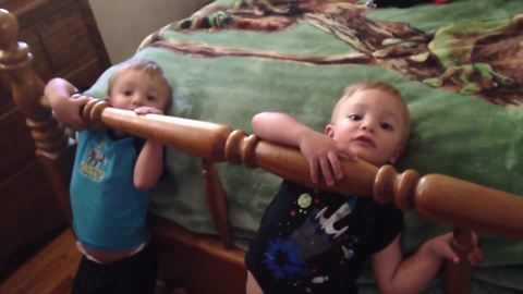Twin Tots Both Get Stuck in A Bed Frame