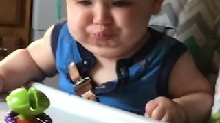 Adorable Baby Plays An Imaginary Trumpet