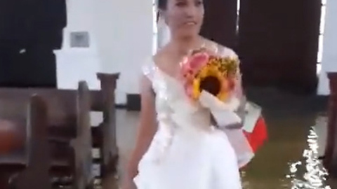 Bride Wades Through Flooded Church Aisle in Aftermath of Monsoon