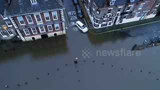River bursts banks flooding historic UK city of York - Video