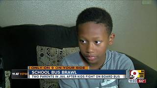 Two parents in jail after school bus brawl - Video