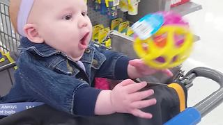 A Baby Girl Discovers A Baby Rattle - Video