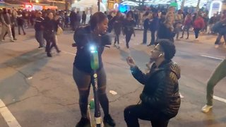 Prankster proposes to complete stranger outside super bowl event leading to street celebrations
