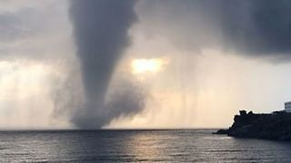 Waterspout Spotted Sweeping Across Sea Off Italian Island - Video