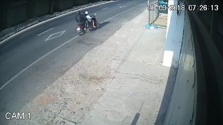 Shocking CCTV footage shows high-speed motorbike collision in Vietnam - Video