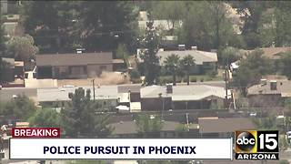 RAW: Police pursuit suspect crashes into front yard - Video