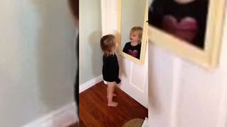 Toddler Loves Her Reflection