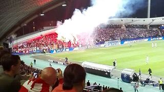 Spartak Moscow Fans Throw Flare at Champions League Match - Video