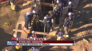 Construction worker trapped in trench dies - Video