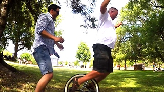 Dads have hilarious time on birthday clown's unicycle - Video