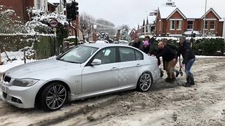 BMW driver stuck in snow in St Albans - Video